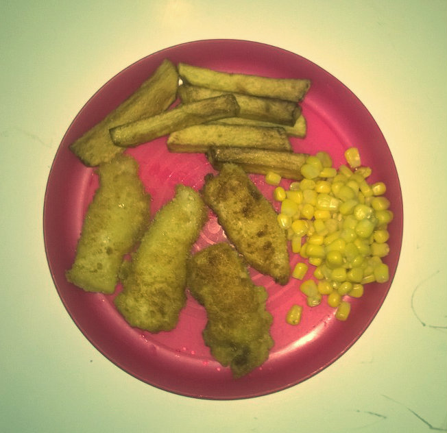 Homemade chips, fishfingers and sweetcorn. Miraculously, sweetcorn excretes it's nutrients so the fishfingers can absorb them through the process of osmosis. Not actual eating is required.